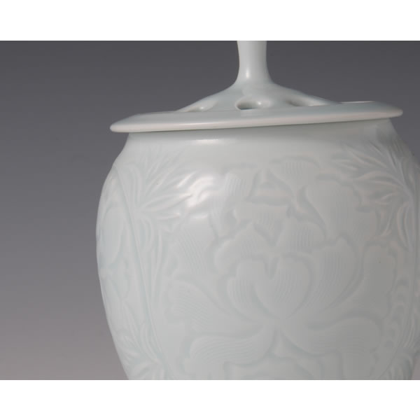 SEIHAKUJI KAMONKORO (White Porcelain Incense Burner in engraved Flower design with Pale Blue glaze)